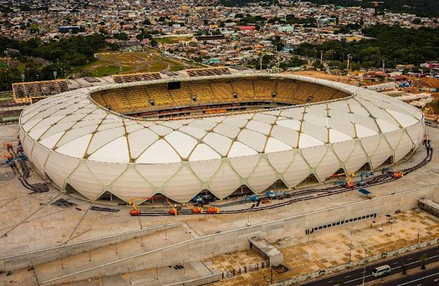 FILE - In this This March 9, 2014, file photo, released by Portal da Copa shows Arena da Amazonia stadium on the day of its inauguration in Manaus in the state of Amazonas, Brazil, Sunday. Three stadiums still have to be finished, including the one hosting the opener in Sao Paulo in about three months. (AP Photo/Jose Zamith, Portal da Copa,File) - SEE FURTHER WORLD CUP CONTENT AT APIMAGES.COM