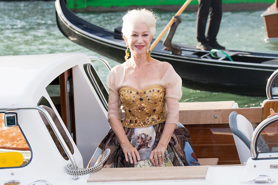 <p>Helen Mirren looks glamorous as she arrives by boat to the Dolce & Gabbana Alta Moda show on August 29 in Venice. </p>