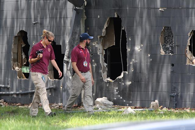 <p>Investigators from the office of the medical examiner investigate on the west side of Pulse nightclub where a gunman opened fire on Sunday morning, June 12, 2016, in Orlando, Fla. (Doug Clifford/The Tampa Bay Times via AP) </p>