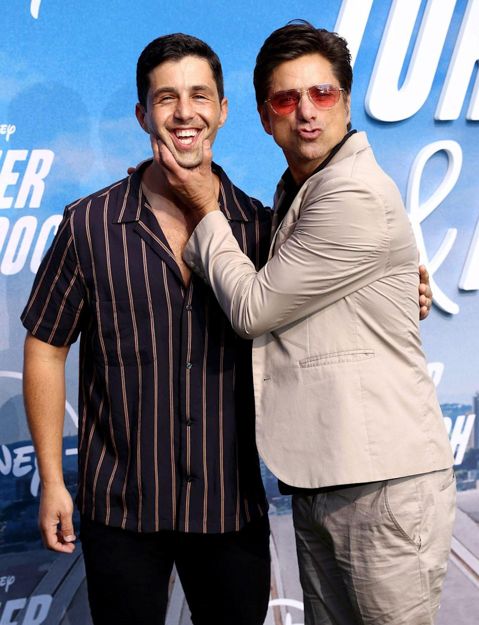 <p>Josh Peck and John Stamos attend the Disney+ <em>Turner & Hooch</em> premiere at the Westfield Century City Mall on July 15 in L.A.</p>