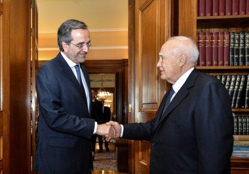New Democracy leader Antonis Samaras (left) meets Greek President Carolos Papoulias in Athens. Samaras was been sworn in as the prime minister of new Greek coalition, as he took up the challenge of trying to revise the terms an unpopular EU-IMF bailout deal