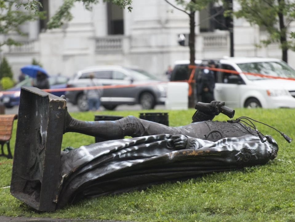 """<span class=""""caption"""">Protestors toppled a statue of Sir John A. Macdonald after a demonstration in Montréal on Aug. 29, 2020.</span> <span class=""""attribution""""><span class=""""source"""">(THE CANADIAN PRESS/Graham Hughes)</span></span>"""