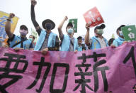 "Taiwanese workers shout and hold slogans reading ""Increase Salary, Secure Annuity"" during a May Day rally in Taipei, Taiwan, Saturday, May 1, 2021. Thousands of protesters from different labor groups protest on the street to ask for increasing salary and securing annuity. (AP Photo/Chiang Ying-ying)"
