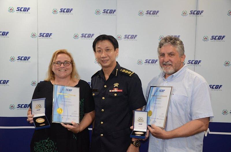 Mrs and Mr Valenta flanking Colonel Lim Boon Hwee (centre), commander of the 1st SCDF division on 3 May, 2019. (PHOTO: SCDF/Facebook)