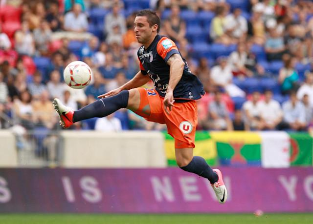 HARRISON, NJ - JULY 28: Emanuel Herrera #11 of Montpellier HSC plays the ball against Olympique Lyonnais during the Tours de Champions at Red Bull Arena on July 28, 2012 in Harrison, New Jersey. Game ended in a 2-2 tie. Olympique Lyonnais won 4-2 in penalty kicks. (Photo by Mike Stobe/Getty Images for New York Red Bulls)
