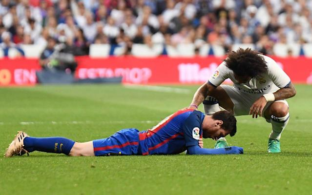 <span>Messi lies on the turf with blood pouring from his mouth</span> <span>Credit: Rex Features </span>
