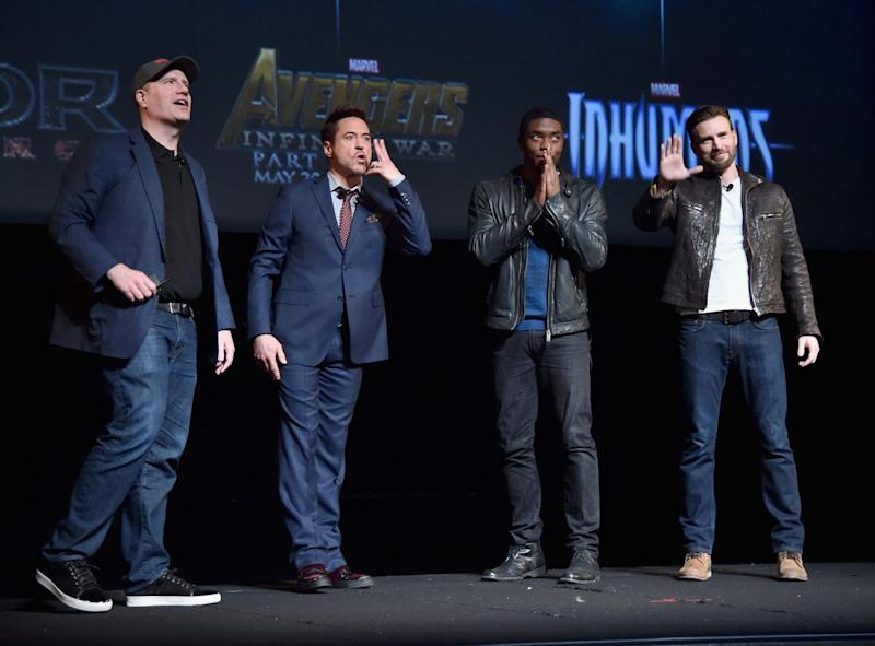 Kevin Feige, Robert Downey Jr., Chadwick Boseman and Chris Evans at the Oct. 28, 2014 press event that introduced Boseman as the Marvel Cinematic Universe's Black Panther. (Photo Getty/Disney/Marvel)