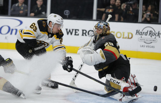 Boston Bruins center Brad Marchand (63) attempts a shot on Vegas Golden Knights goaltender Marc-Andre Fleury (29) during the third period of an NHL hockey game Tuesday, Oct. 8, 2019, in Las Vegas. (AP Photo/John Locher)