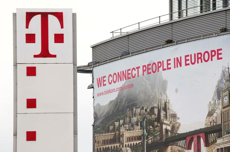 FILE PHOTO: The logo of German telecommunications giant Deutsche Telekom AG is seen at the company's headquarters in Bonn