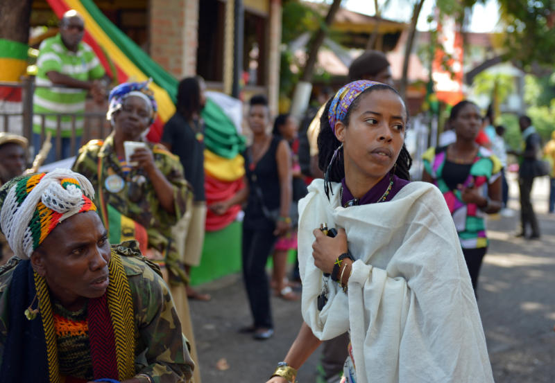 ** CORRECTS STYLE OF MUSIC IN FIRST SENTENCE** Bob Marley's granddaughter Donisha Prendergast, right, dances to the sound of a Rastafarian drum, during the celebration of Marley's 68th birthday in the yard of his Kingston home, in Jamaica, Wednesday, Feb. 6, 2013. Marley's relatives and old friends were joined by hundreds of tourists to dance and chant to the pounding of drums to honor the late reggae icon who died of cancer in 1981 at age 36. (AP Photo/ David McFadden)
