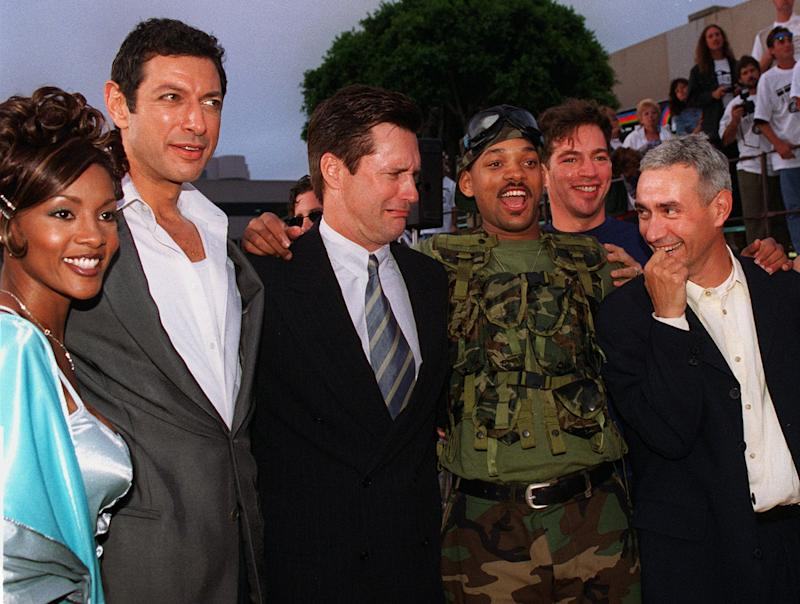 "Will Smith, wearing military fatigues, star of ""Independence Day"" poses for a photo with fellow cast members, from left to right, Vivica Fox, Jeff Goldblum, Bill Pullman, Smith, singer Harry Connick Jr., and German director/executive producer/co-creator Roland Emmerich during the film's premiere in the Westwood section of Los Angeles Tuesday, June 25, 1996. (AP Photo/Kevork Djansezian)"