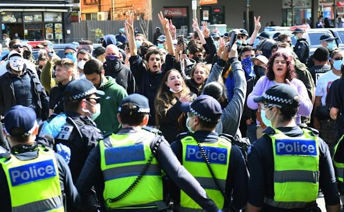 Australian police arrested dozens at an anti-lockdown rally in Melbourne on Sunday after crowds defied stay-at-home orders