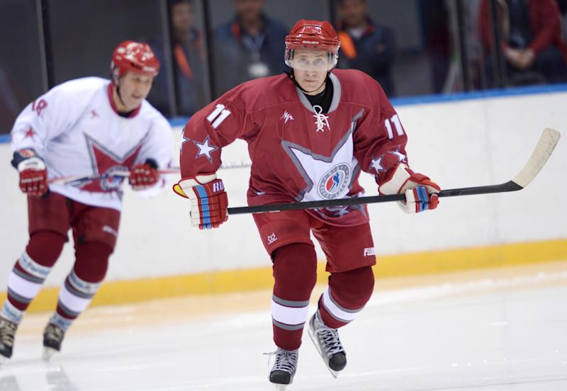 Russian President Vladimir Putin, right, takes part in a friendly hockey match between the Stars of the NHL 1 and the Stars of the NHL 2 teams at The Bolshoy Ice Dome, the part of the complex of facilities operated by the International Ice Hockey Federation (IIHF) at the Black Sea resort of Sochi, southern Russia, Saturday, Jan. 4, 2014. (AP Photo/RIA-Novosti, Alexei Nikolsky, Presidential Press Service)
