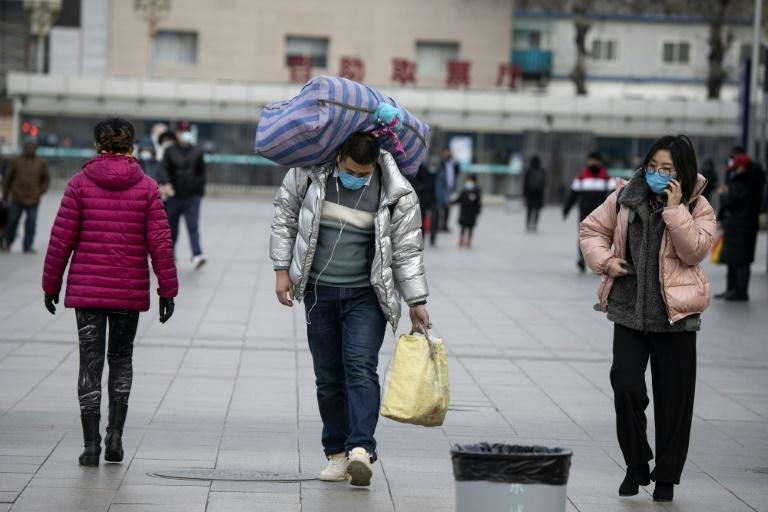 The end of the Lunar New Year holiday has seen an influx of people to Beijing, prompting fear they are bringing the coronavirus with them (AFP Photo/NOEL CELIS)