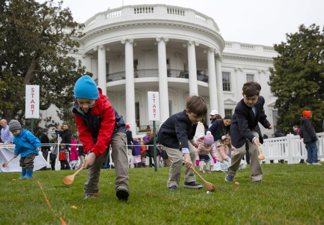 <p>From l-r., Seamus Menefee, 7, from Burke, Va., Skye Kennedy, 5, and his brother Jack Kennedy, 8, both from Montclair, N.J., participates in the annual White House Easter Egg Roll on the South Lawn of the White House in Washington, Monday, April 2, 2018. (Photo: Pablo Martinez Monsivais/AP) </p>