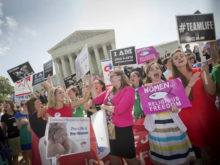 Demonstrators react to hearing the supreme court's decision on the Hobby Lobby birth control case in 2014. ADF successfully argued the store should not be required to pay for birth control included in private insurance plans.