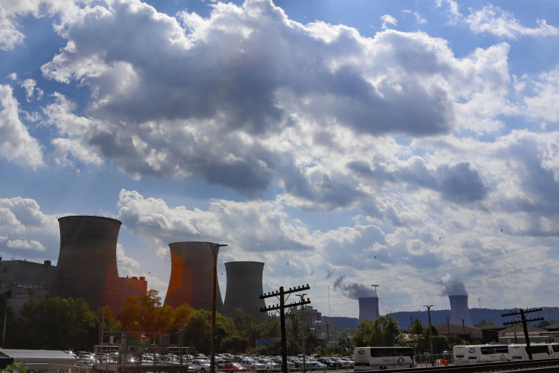 The Bruce Mansfield power plant in Shippingport, Pa., is seen from across the Ohio River from Industry, Pa. on Thursday, Oct. 3, 2019. Owners of coal-fired power plants, like the Bruce Mansfield plant that is scheduled to close next month, could pay more to emit carbon dioxide under Pennsylvania Gov. Tom Wolf's plan announced Thursday to bring Pennsylvania into a nine-state consortium that sets a price and limits on carbon dioxide emissions from power plants to help fight climate change.  (AP Photo/Keith Srakocic)