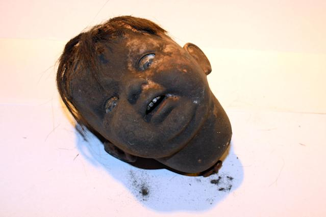 <p>This doll head was found in the northeast fireplace in the basement of 97 Orchard St. in 2012. (Photo: Caters News) </p>
