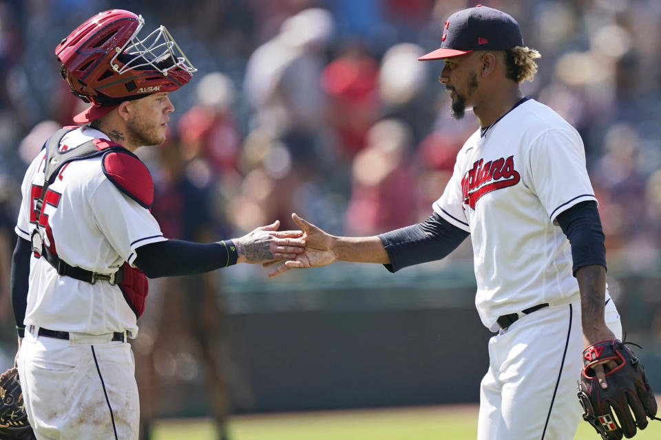 Cleveland Indians relief pitcher Emmanuel Clase, right, is congratulated by catcher Roberto Perez after they defeated the Tampa Bay Rays in a baseball game, Sunday, July 25, 2021, in Cleveland. (AP Photo/Tony Dejak)