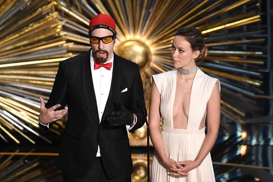 """<div class=""""inline-image__caption""""><p>Sacha Baron Cohen (as Ali G) and Olivia Wilde speak onstage during the 88th Annual Academy Awards at the Dolby Theatre on February 28, 2016, in Hollywood, California. </p></div> <div class=""""inline-image__credit"""">Kevin Winter/Getty</div>"""