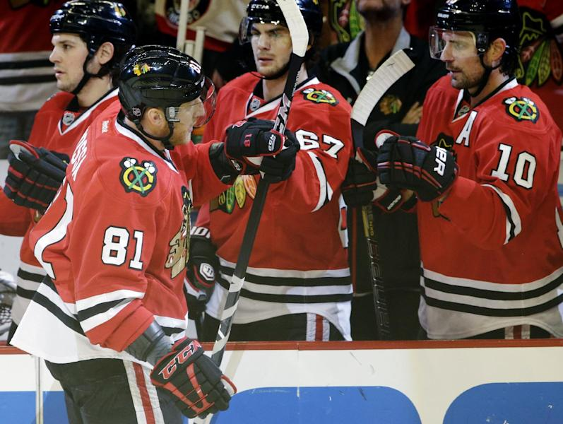 Chicago Blackhawks' Marian Hossa (81) celebrates with teammates after scoring a goal during the first period of Game 5 of an NHL hockey Stanley Cup first-round playoff series against the Minnesota Wild in Chicago, Thursday, May 9, 2013. (AP Photo/Nam Y. Huh)