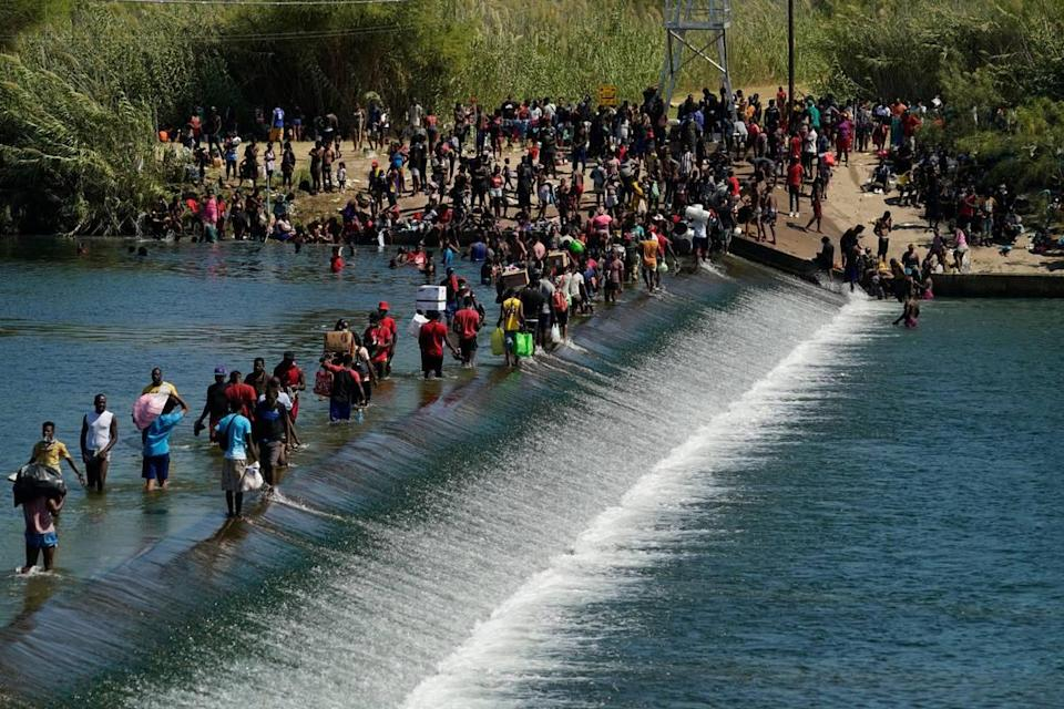 Thousands of Haitian migrants used a dam to cross to and from the United States from Mexico, Friday, Sept. 17, 2021, in Del Rio, Texas.