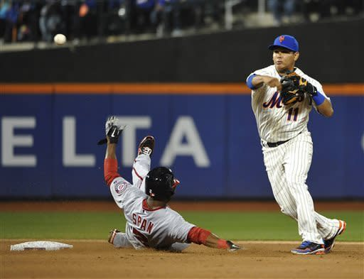 New York Mets shortstop Ruben Tejada (11) throws to first base for the double play after getting Washington Nationals' Denard Span , left, out at second base in the sixth inning of a baseball game at Citi Field, Friday, April 19, 2013, in New York. (AP Photo/Kathy Kmonicek)