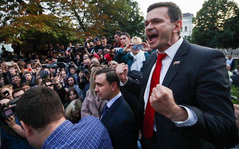 Disqualified candidate Ilya Yashin, an ally of slain Putin critic Boris Nemtsov, speaks at a protest on Monday - TASS