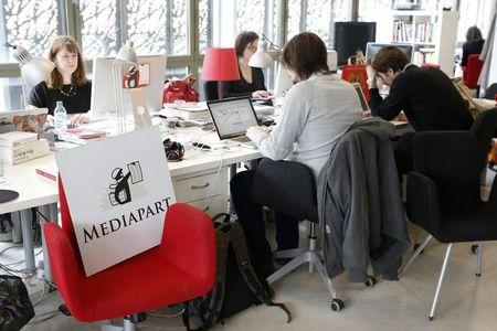 "Journalists work in the newsroom at the offices of French investigative news website ""Mediapart"" in Paris"
