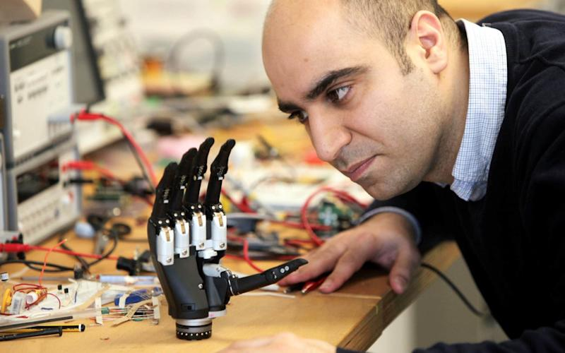 "The new bionic hand ""sees"" objects and instantly decides what kind of grip to adopt - Credit:  Mike Urwin/Newcastle University"