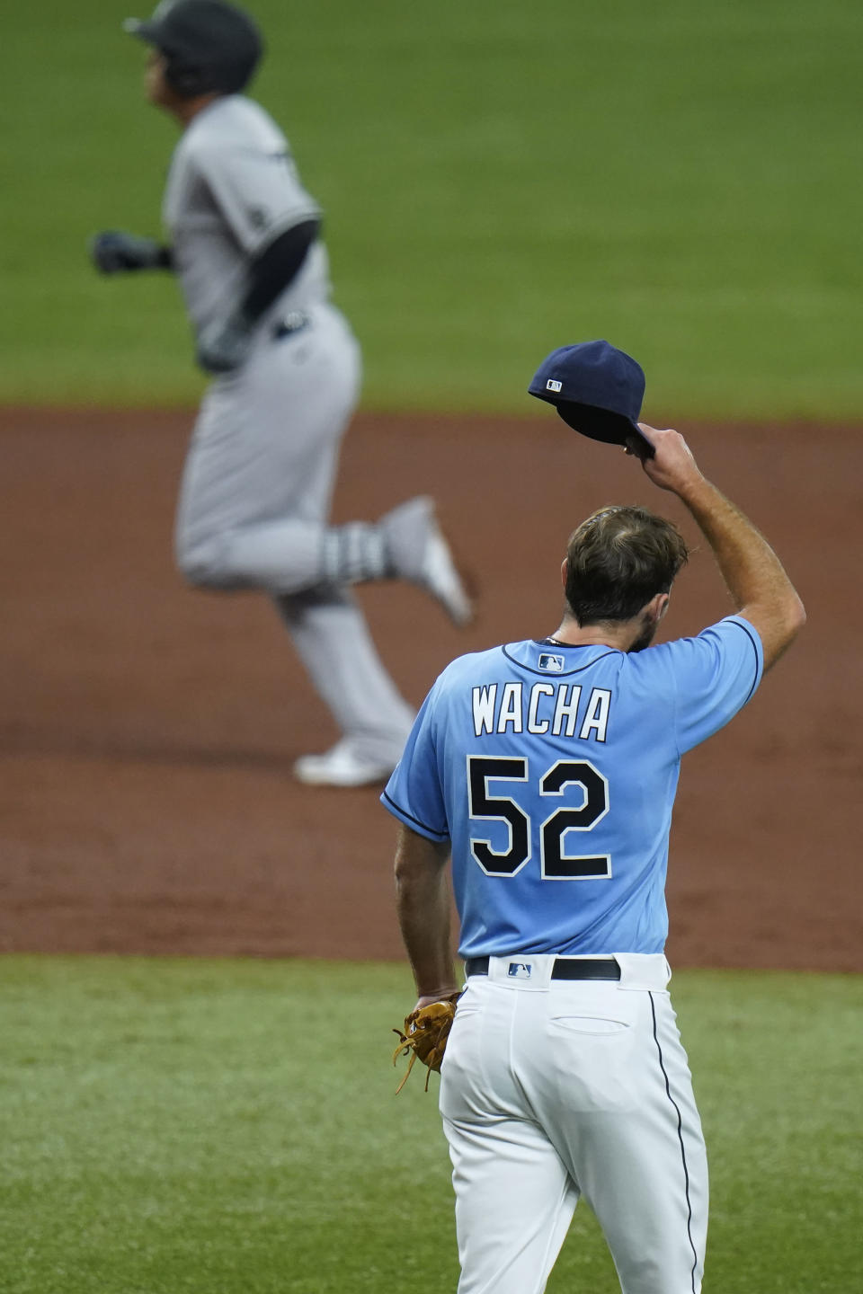 Tampa Bay Rays starting pitcher Michael Wacha (52) reacts as New York Yankees' Gio Urshela runs around the bases after his two-run home run during the third inning of a baseball game Sunday, April 11, 2021, in St. Petersburg, Fla. (AP Photo/Chris O'Meara)