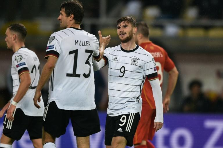 Timo Werner (R) scored twice as Germany qualified for the 2022 World Cup (AFP/Nikolay DOYCHINOV)