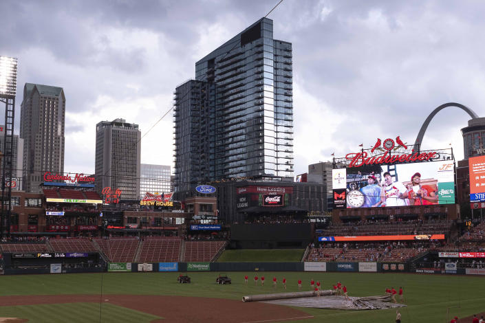 Busch Stadium is viewed as the field crew puts on the tarp during a rain delay in a baseball game between the Pittsburgh Pirates and the St. Louis Cardinals Sunday, June 27, 2021, in St. Louis. (AP Photo/Joe Puetz)