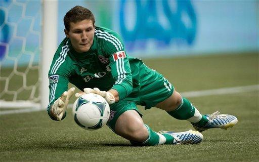 Toronto FC goalkeeper Joe Bendik makes a save against the Vancouver Whitecaps during the first half of an MLS soccer game in Vancouver, British, Columbia, Saturday, March 2, 2013. (AP Photo/The Canadian Press, Darryl Dyck)