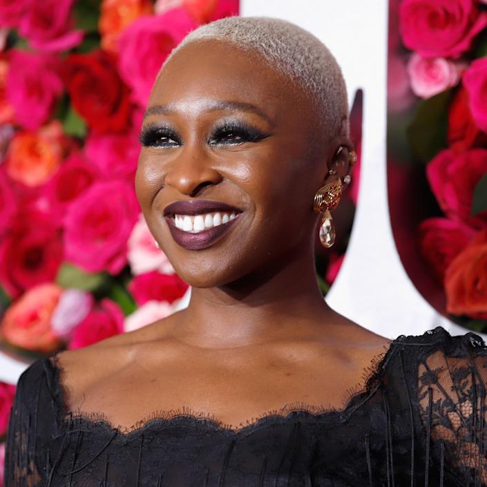 """Cynthia Erivo can pull off nearly any color — including barely any color at all. A tone this bleached-out looks best on hair that is quite short: For one, it can be damaging on really long strands, and two, it makes a sharper visual statement, especially against darker skin tones. """"Cynthia's super-cool haircut with platinum white blonde complements her skin tone well and makes her stand out,"""" adds <a href=""""https://www.instagram.com/hitomicolorist/?hl=en"""" rel=""""nofollow noopener"""" target=""""_blank"""" data-ylk=""""slk:Hitomi Ikeda"""" class=""""link rapid-noclick-resp"""">Hitomi Ikeda</a>, colorist at <a href=""""https://www.instagram.com/robpeetoomnyc/?hl=en"""" rel=""""nofollow noopener"""" target=""""_blank"""" data-ylk=""""slk:Rob Peetoom Williamsburg"""" class=""""link rapid-noclick-resp"""">Rob Peetoom Williamsburg</a> in Brooklyn, New York. She could even bleach her eyebrows along with her hair and pull it off seamlessly."""