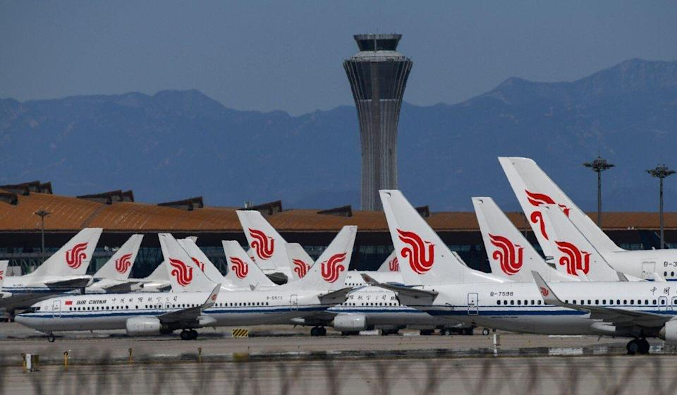 Air China planes parked on the tarmac at Beijing Capital Airport. Mainland airlines have raised concerns over the new target date. Photo: AFP