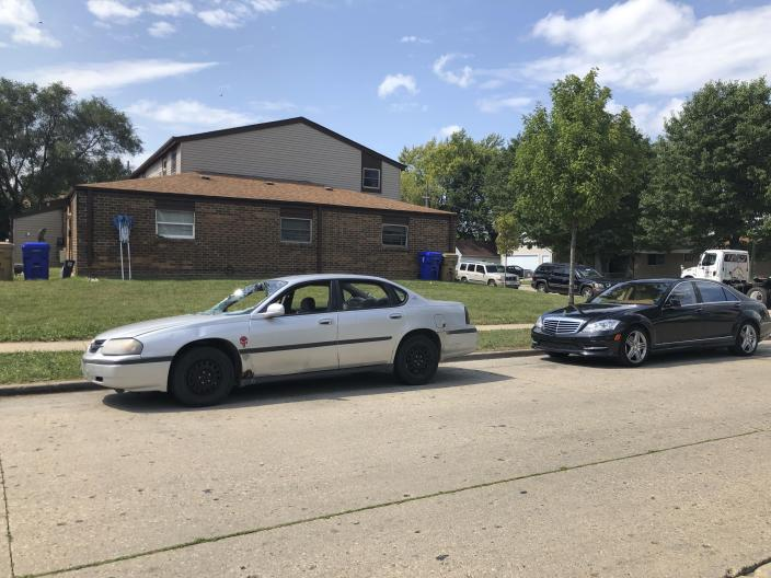 Vehicles are parked Friday, Aug. 28, 2020, in Kenosha, Wis., where Jacob Blake, a Black man, was shot by police on Aug. 23. The city and its surrounding county remained under a curfew amid protest in the city. (AP Photo/ Russell Contreras)