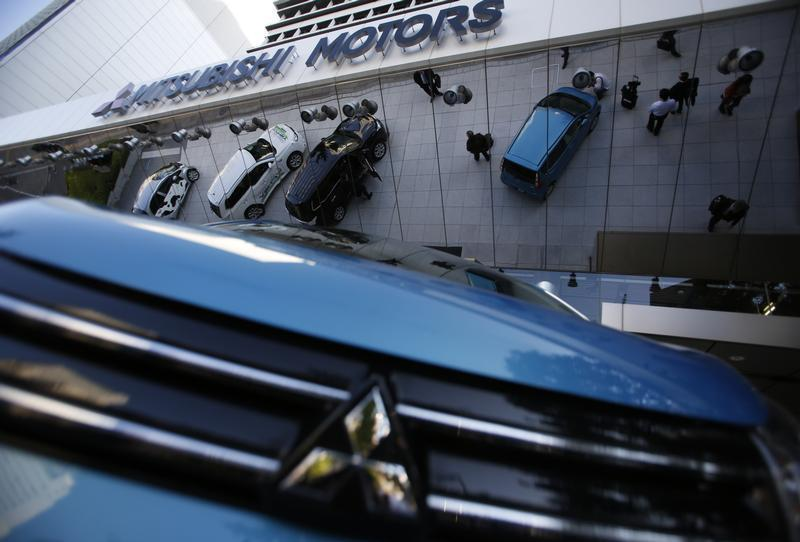 Mitsubishi Motors Corp's vehicles are seen at the company headquarters in Tokyo