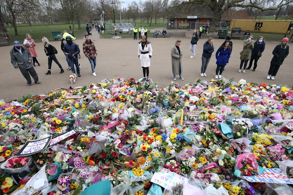 Deputy Labour Leader Angela Rayner (centre) looks at flowers after laying a floral tribute at the bandstand in Clapham Common, London, for murdered Sarah Everard. Picture date: Tuesday March 16, 2021.