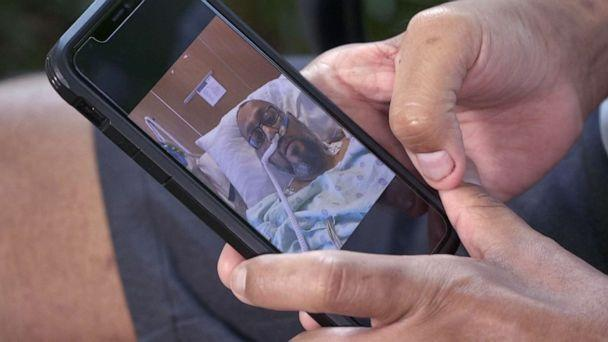 PHOTO: Joshua Garza looks at photos of himself when he was severely ill with COVID-19 in early 2021, in Sugarland, Texas, on June 16, 2021. (ABC News)