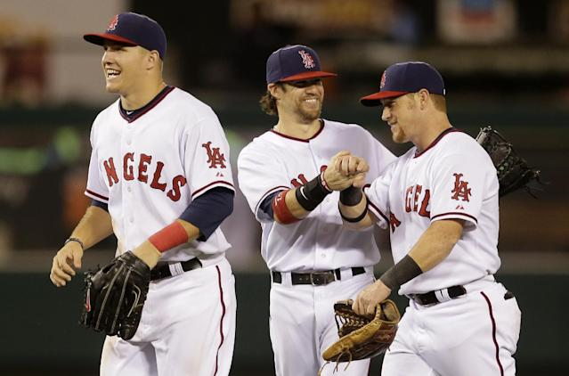 Los Angeles Angels center fielder Mike Trout, from left, right fielder Collin Cowgill and right fielder Kole Calhoun celebrate after their win against the Tampa Bay Rays during a baseball game in Anaheim, Calif., Thursday, Sept. 5, 2013. (AP Photo/Chris Carlson)