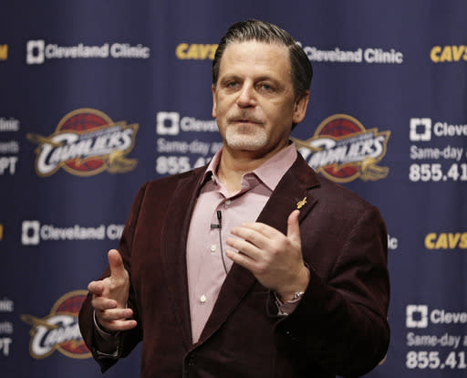Cleveland Cavaliers owner Dan Gilbert answers questions before the Cavaliers' NBA basketball game against the Brooklyn Nets on Wednesday, Oct. 30, 2013, in Cleveland. (AP Photo/Tony Dejak)