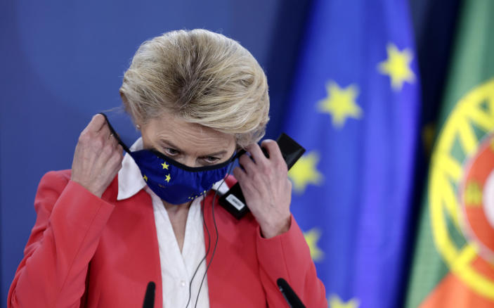 European Commission President Ursula von der Leyen takes off her protective face mask prior to addressing a media conference at an EU summit in Porto, Portugal, Saturday, May 8, 2021. On Saturday, EU leaders held an online summit with India's Prime Minister Narendra Modi, covering trade, climate change and help with India's COVID-19 surge. (AP Photo/Luis Vieira, Pool)