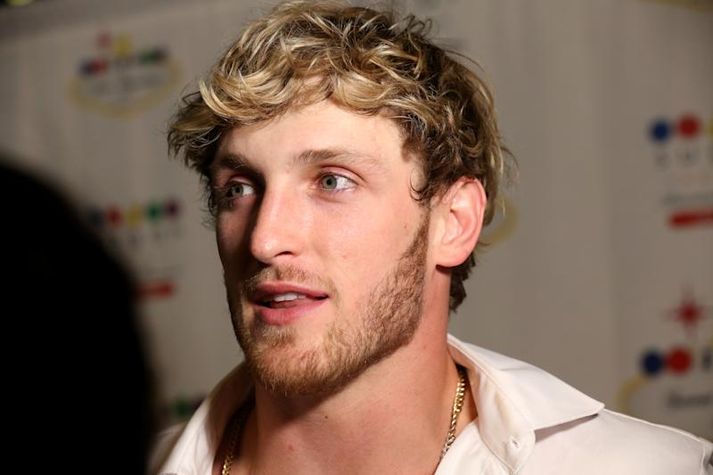 LAS VEGAS, NEVADA - JULY 28: Logan Paul speaks to an interviewer during the wedding reception for Jake Paul and Tana Mongeau at the Sugar Factory American Brasserie at the Fashion Show mall on July 28, 2019 in Las Vegas, Nevada. (Photo by Gabe Ginsberg/Getty Images)