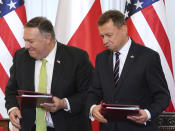 US Secretary of State Mike Pompeo, left, and Poland's Minister of Defence Mariusz Blaszczak after signing the US-Poland Enhanced Defence Cooperation Agreement in the Presidential Palace in Warsaw, Poland, Saturday Aug. 15, 2020. Pompeo is on a five day visit to central Europe. (Janek Skarzynski/Pool via AP)
