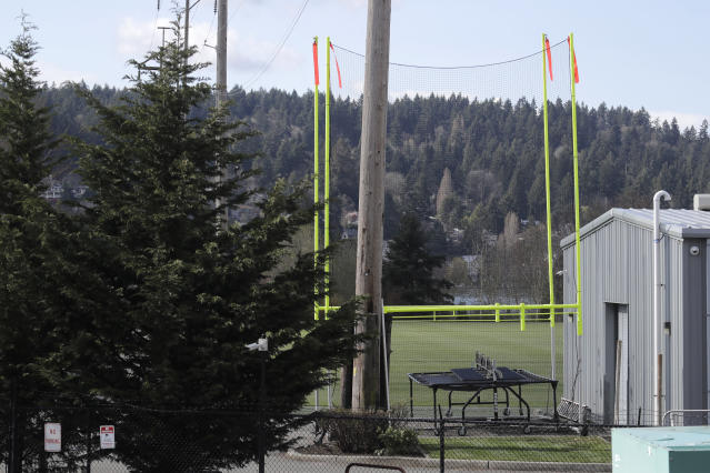 Goal posts and other training equipment sit idle at the Seattle Seahawks' NFL football practice facility and headquarters Wednesday, March 25, 2020, in Renton, Wash. NFL Commissioner Roger Goodell has instructed all 32 teams to close their facilities to all but a select few employees as a safeguard against the new coronavirus. AP Photo/Ted S. Warren)