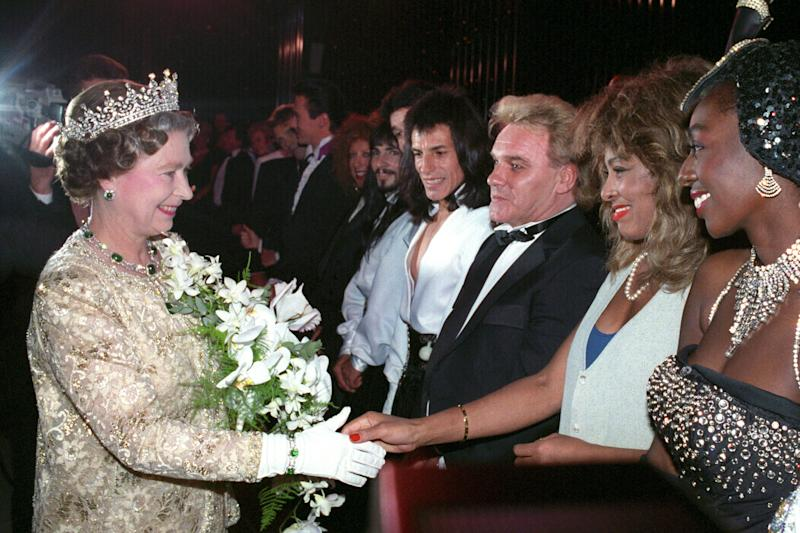 The Queen meets singer Tina Turner, second from the right, watched by comedian Freddie Starr after the Royal Variety Performance at the London Palladium. (Photo by PA Images via Getty Images)