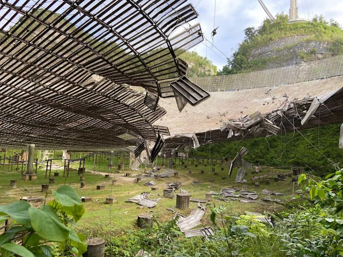 A 100-foot-wide hole in the 1,000-foot-wide reflector dish of the Arecibo Observatory, torn when a cable fell on August 10, 2020.