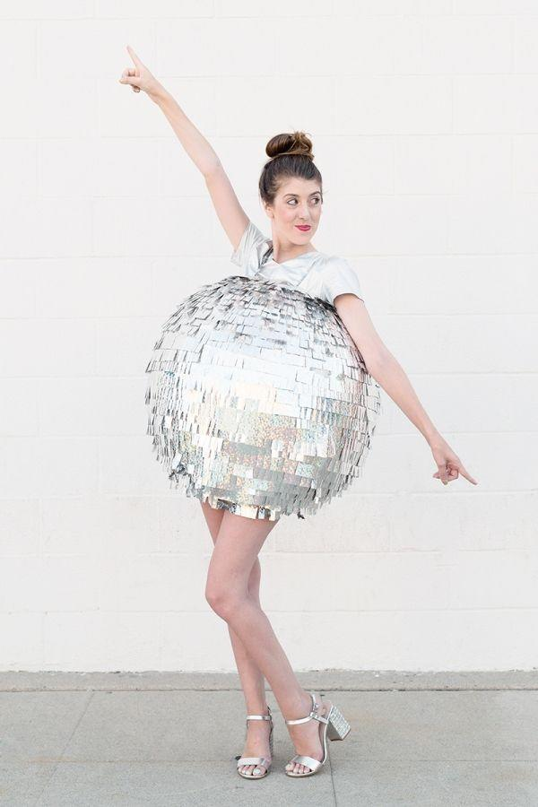 """<p>This disco ball costume is surprisingly easy to make! Pair with a silver shirt and silver pumps to complete your look.</p><p><em><a href=""""https://studiodiy.com/diy-disco-ball-costume//"""" rel=""""nofollow noopener"""" target=""""_blank"""" data-ylk=""""slk:Get the tutorial at Studio DIY »"""" class=""""link rapid-noclick-resp"""">Get the tutorial at Studio DIY »</a></em></p>"""