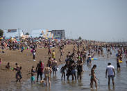 Crowds gather at Southend beach as temperatures soar to as high as 34 degrees across the UK.
